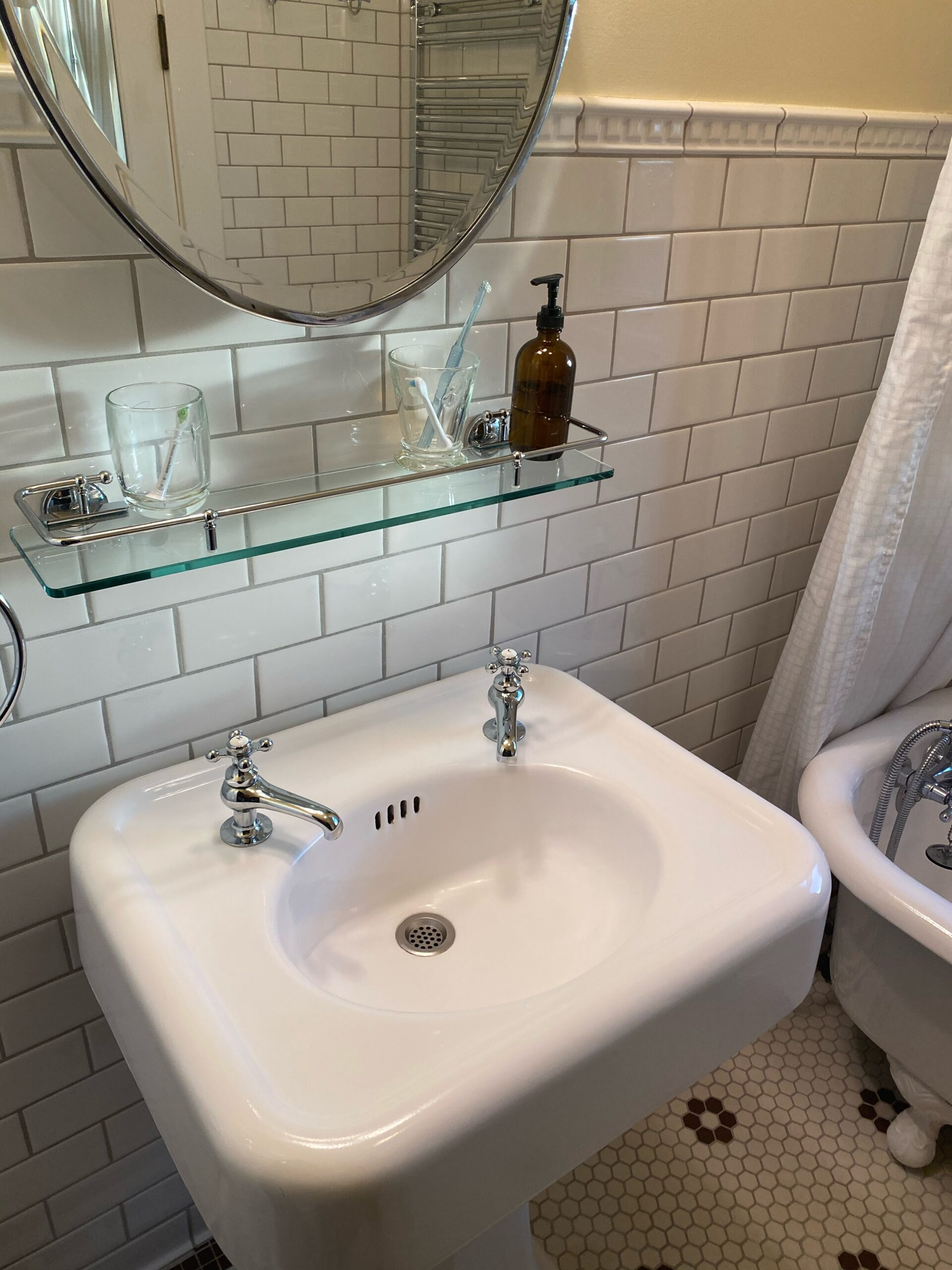 hot and cold replacement taps in vintage bathroom